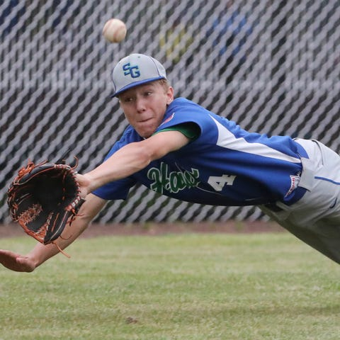 St. Georges' Noah Finocchiaro stretches but can't...