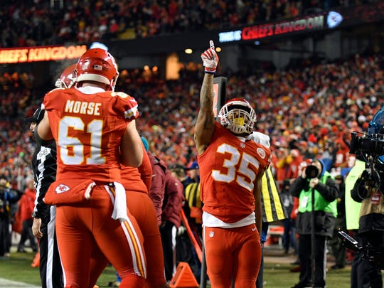 Kansas City Chiefs running back Charcandrick West (35) celebrates his touchdown during the first half against the Oakland Raiders in Kansas City, Mo., Thursday, Dec. 8, 2016.