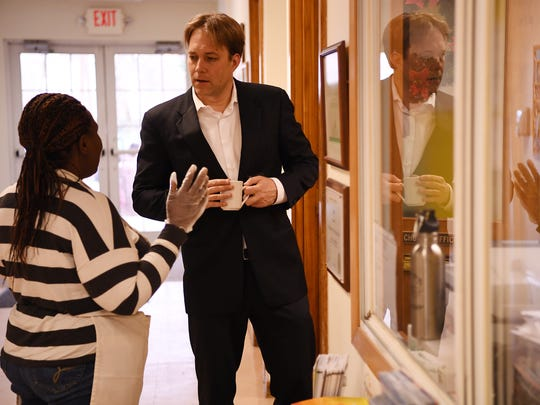 The Rev. Seth Kaper-Dale, of the Reformed Church of Highland Park, here talking in December 2016 with Yvonne Mukayisenga, a refugee from the Democratic Republic of Congo.