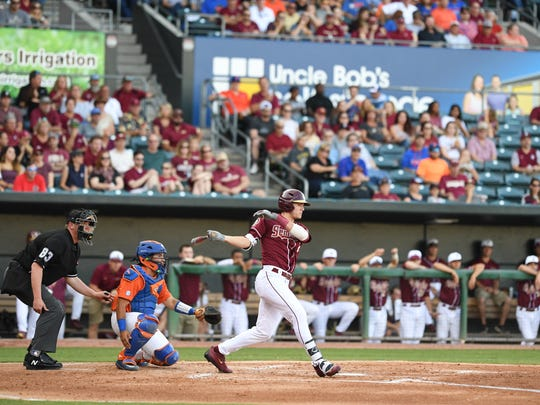 Florida State sophomore left fielder Jackson Lueck fouls off a pitch during his team's 4-1 loss to Florida at the Baseball Grounds of Jacksonville on Tuesday night.