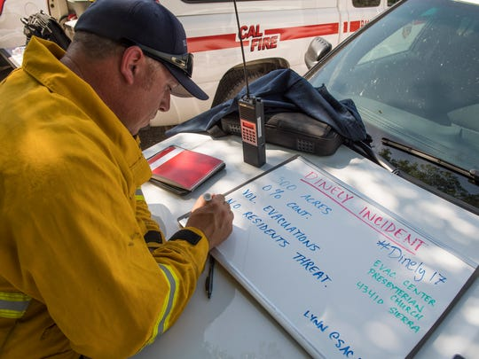 Tulare County Fire Cpt. Joe Rosa Jr. updates the Dinely