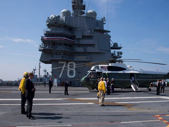 US President Donald Trump is welcomed aboard the USS Gerald R. Ford in Norfolk, Virginia, on Saturday.