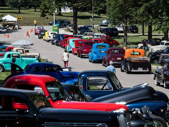 Hot rods of all shapes and sizes funnel out of the Vanderburgh County 4-H fairgrounds as the 43rd Annual Frog Follies car show ends on Sunday afternoon, Aug. 27, 2017.