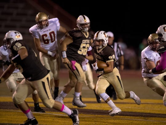 Central's Holton Zoss (56) watches Reeder Pennell run for a big gain after creating a hole through the Mater Dei defense last season.