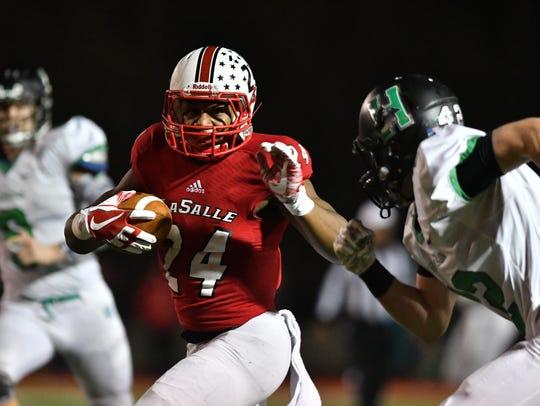 La Salle's Cam Porter breaks off a long run that would