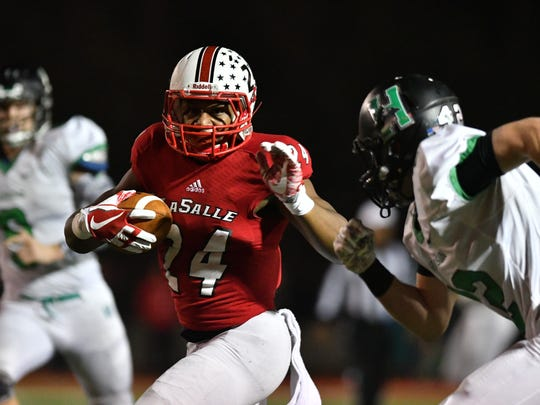La Salle's Cam Porter breaks off a long run that would set up a first half touchdown for LaSalle Friday, November 23rd at LaSalle High School
