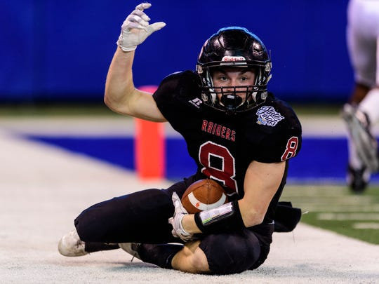 Southridge's Tucker Schank (8) throws his hand up in excitement after making a long-yard run during the first quarter of the IHSAA Class 2A State Championship at Lucas Oil Stadium in Indianapolis, Ind., Saturday, Nov. 25, 2017.