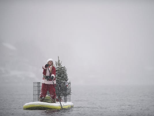 Santas on Paddle Boards