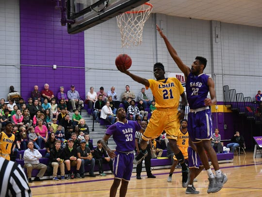 LSUA forward Brandon Moss (21) finishes around the