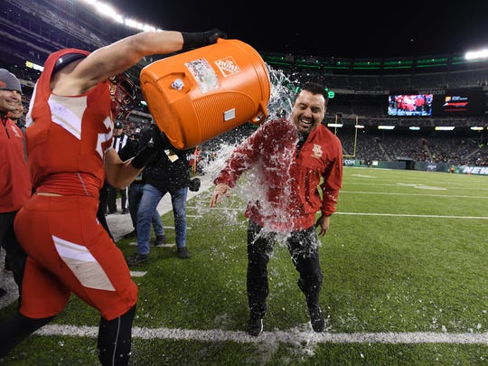 Bergen Catholic coach Nunzio Campanile gets water dumped on him as BC begins to celebrate defeating St. Peter's in the Non-Public Group 4 state football final at MetLife Stadium in East Rutherford, on Friday, Dec. 1, 2017.