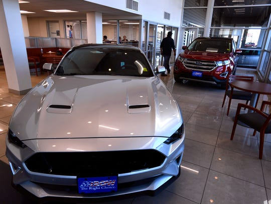 New cars are parked in the showroom at Arrow Ford. The Abilene dealership was awarded Small Employer of the Year for 2017 by the Texas Workforce Commission.
