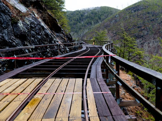 Caution tape marks the construction area along a damaged section of the Ocoee Flume in Benton, Tennessee on Wednesday, February 7, 2018. The flume, built in 1912, was damaged by a November rockslide. Repairs will take until June of this year.