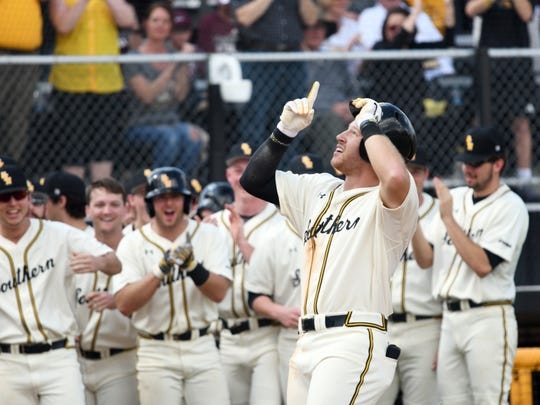 Southern Miss' Luke Reynolds celebrates after hitting a home run in the game against Mississippi State on Saturday at Pete Taylor Park.