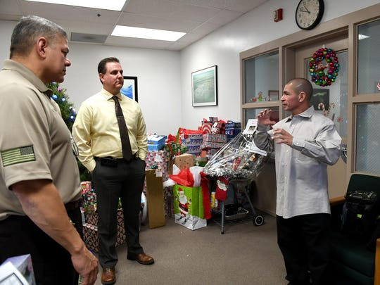 Placencia speaks with then-Warden William Muniz (far left) and Associate Warden Ed Borla while visiting to speak with inmates at Salinas Valley State Prison in December.