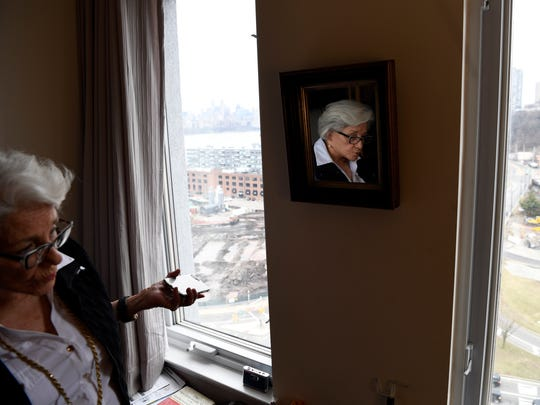 Irene Stella looks at the Quanta Superfund site from her apartment on River Road in Edgewater on Thursday, March 1, 2018.