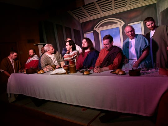 Actors in Living Last Supper perform during dress rehearsal Wednesday at St. James United Methodist Church. The play is a tableau depicting Leonardo DaVinci's Last Supper with actors representing the figures and stepping forward to deliver a monologue.