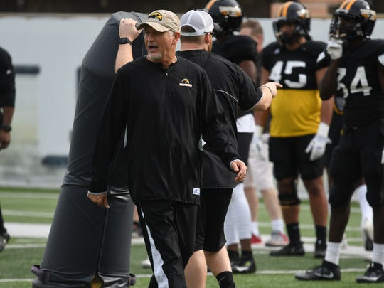 Southern Miss defensive coordinator Tim Billings communicates