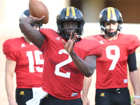 Southern Miss quarterback Keon Howard throws during