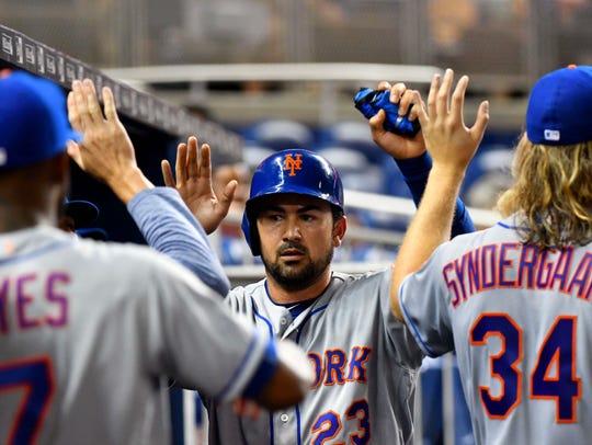 New York Mets first baseman Adrian Gonzalez (23) celebrates