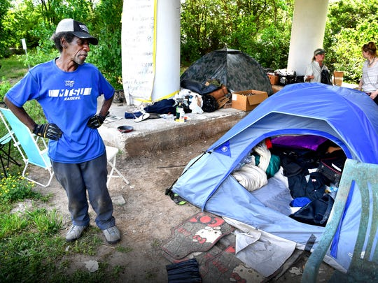 "Irving Scott ""I made it through a tough winter in this tent and now that the heat has come they want to throw us out"", he says talking about Metro's plan to close one of Nashville's largest homeless camps, called Ellington Camp, in East Nashville. Many of the residents have no where else to go. Wednesday May 2, 2018, in Nashville, Tenn."