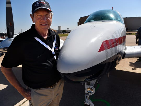 Rob Bowen stands beside a Beechcraft Baron B55 during the Dyess Big Country Air & Space Expo May 12. Bowen is part owner of the aircraft, which is covered in the names of U.S. military personnel who have died in the Global War on Terror.