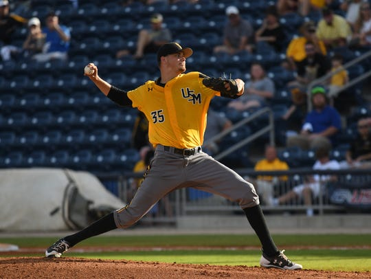 Southern Miss pitcher Walker Powell delivers to the