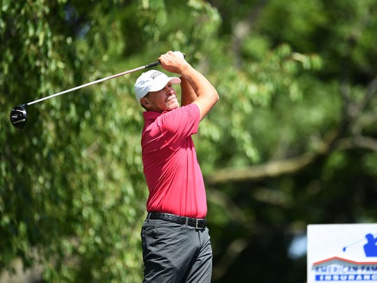 Tournament host Steve Stricker hits his tee shot on