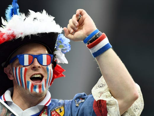 A France fan cheers prior to the semifinals against