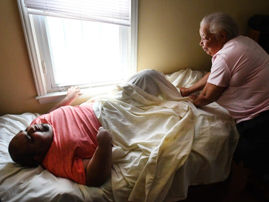 Debra Westbrook takes care of her son Marvin McQueen,