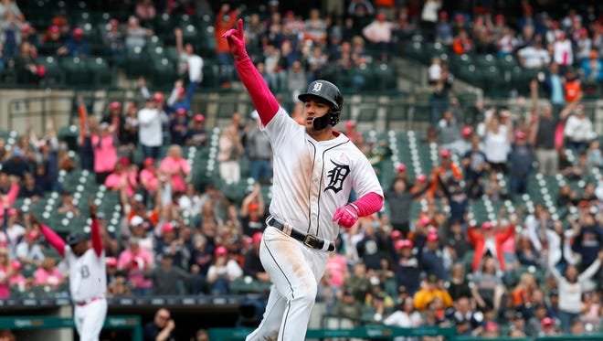 Detroit Tigers' Jose Iglesias celebrates his walk-off single against the Seattle Mariners in the ninth inning of a baseball game in Detroit, Sunday, May 13, 2018. Detroit won 5-4.