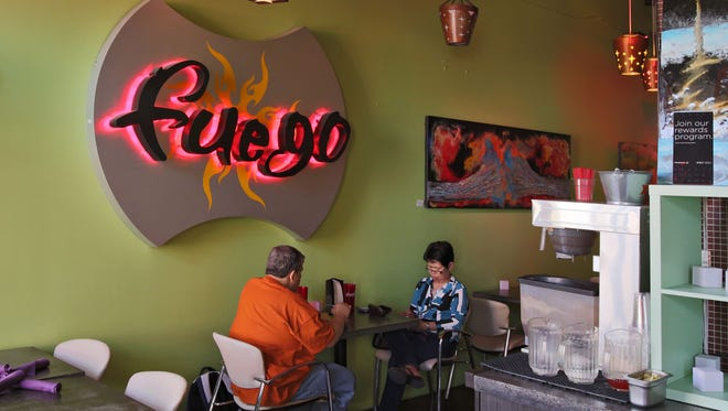 Fuego Cityscape is a tiny restaurant decorated with a crazy-quilt color palette.