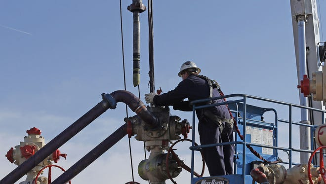 Perforating tools, used to create fractures in the rock, are lowered into one of six wells during a roughly two-week hydraulic fracturing operation at an Encana Corp. well pad near Mead, Colo.