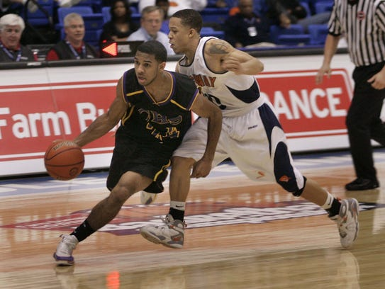 Clarksville High's Tyrone Caldwell dribbles around