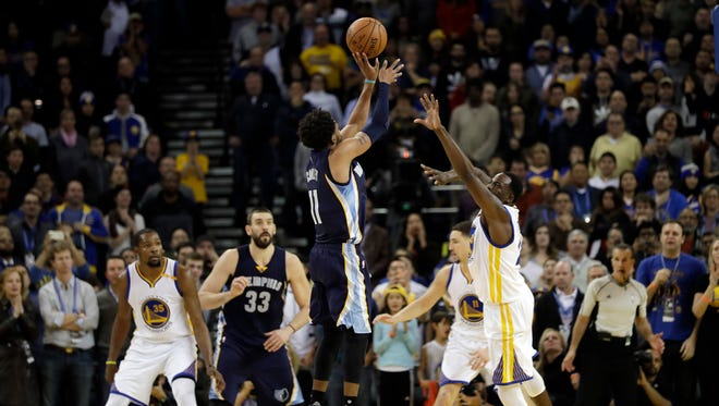 Memphis Grizzlies guard Mike Conley made a game-winning basket against the Golden State Warriors on Friday.
