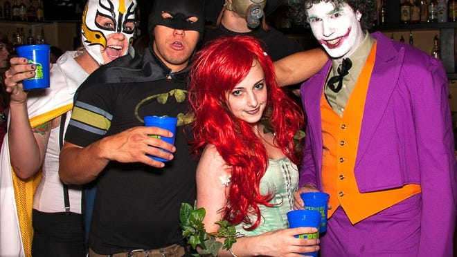 Batman with nemeses including the Joker and Poison Ivy at the 2012 Superhero Crawl.