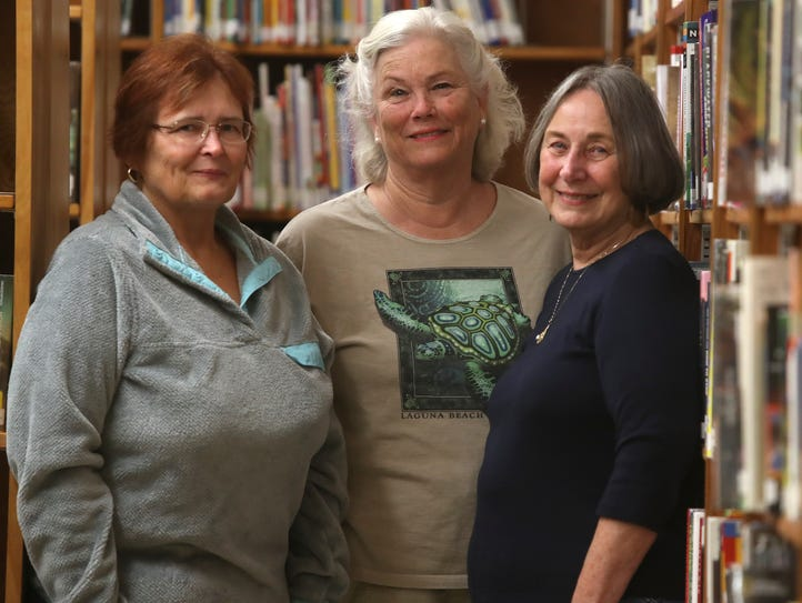 Burney Library board members Mary Barr, from left,