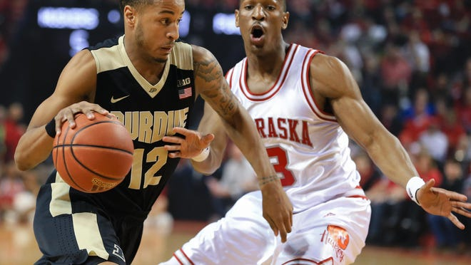 Purdue's Vince Edwards (12) drives past Nebraska's Andrew White III (3) during the first half of an NCAA college basketball game in Lincoln, Neb., Tuesday, March 1, 2016. (AP Photo/Nati Harnik)