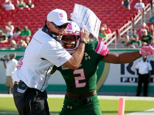 South Florida Bulls defensive back Jamie Byrd (2) is congratulated by defensive coordinator Tom Allen after he forced a fumble Oct 24, 2015, against the Southern Methodist Mustangs during the first quarter at Raymond James Stadium in Tampa, Florida.