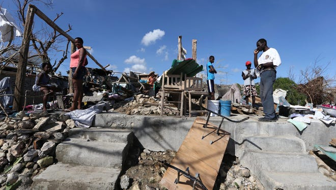 Haitians affected by Hurricane Matthew rebuild their houses in Jeremie, Haiti, on Oct. 11, 2016.