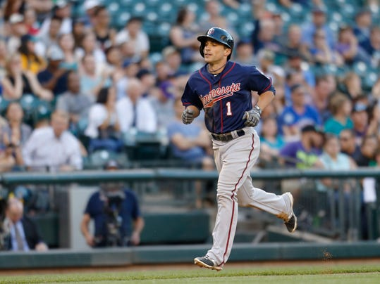 Minnesota Twins' Sam Flud rounds the bases after hitting a solo home run on a pitch from Seattle Mariners' Chris Young during the fifth inning of a baseball game on Tuesday, July 8, 2014 in Seattle. (AP Photo/John Froschauer)
