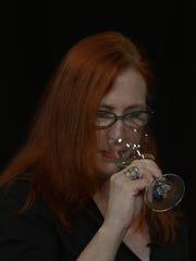 New York City-based wine expert Lisa Carley sniffs