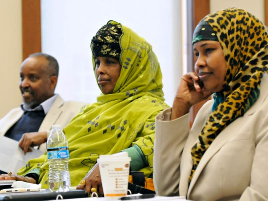 Jama Alimad, Maryan Ahmed and Anab Dahir listen to the discussion during a mediator training session through the Conflict Resolution Center at St. Cloud State University on March 21.