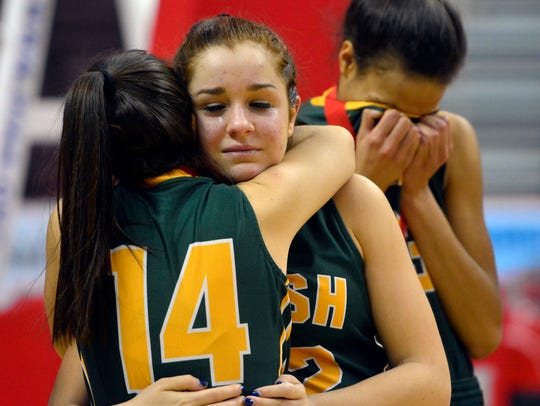Kara Duchek (14) and Katie Bauhof hug after York Catholic