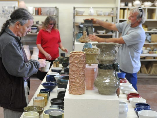 File - Customers shopped one of several tables Friday afternoon at Midwestern State University's Mother's Day Ceramic and Pottery Sale held at the Fain Fine Art building. The sale began on Thursday and will end Sunday with all proceeds going to the ceramic department.
