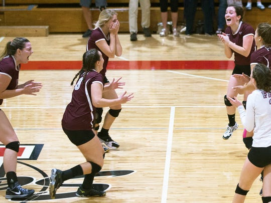 First Baptist Academy players celebrate beating Evangelical Christian School in the Region 3A-3 volleyball final on Thursday, Nov. 2, 2017 at ECS in Fort Myers. FBA beat ECS 3-0.