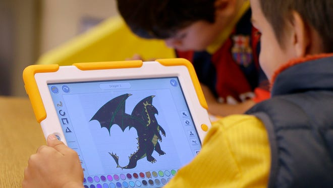In this Thursday, Sept. 18, 2014 photo Aiden Crott, 7, works with his ScratchJr program on an iPad at the Eliot-Pearson Children's School in Medford, Mass. Researchers created the app that teaches basic computer programming to kindergartners. (AP Photo/Stephan Savoia)