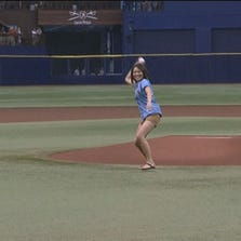 10 News anchor Dion Lim threw out the first pitch before Monday's game between the Rays and the Red Sox