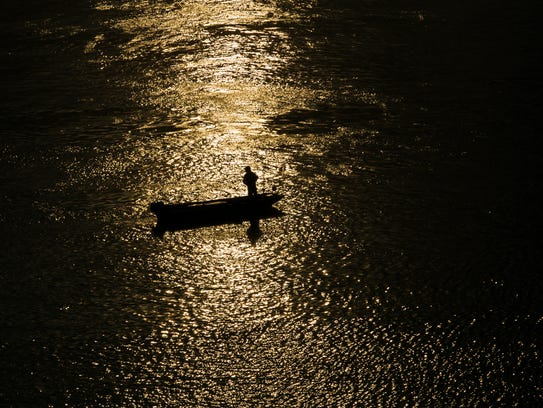 An angler fishes the Mississippi River off Memphis near Beale Street Landing in August.