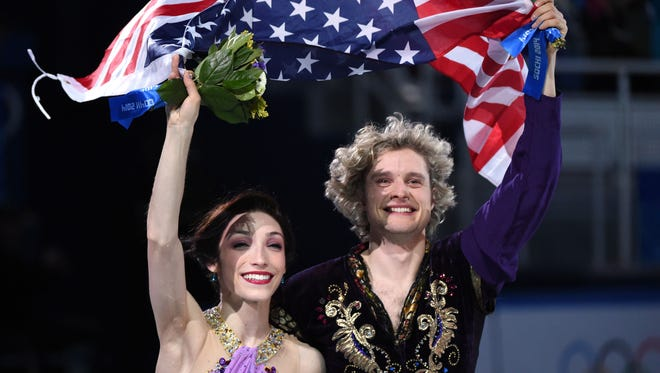 Charlie White and Meryl Davis celebrate winning the gold medal in the free dance program during the 2014 Sochi Olympics.