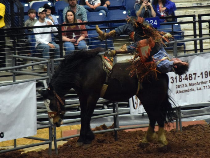 Colter Onya competes in the bareback bronc riding competition